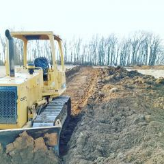 Plow Moving Dirt Piles